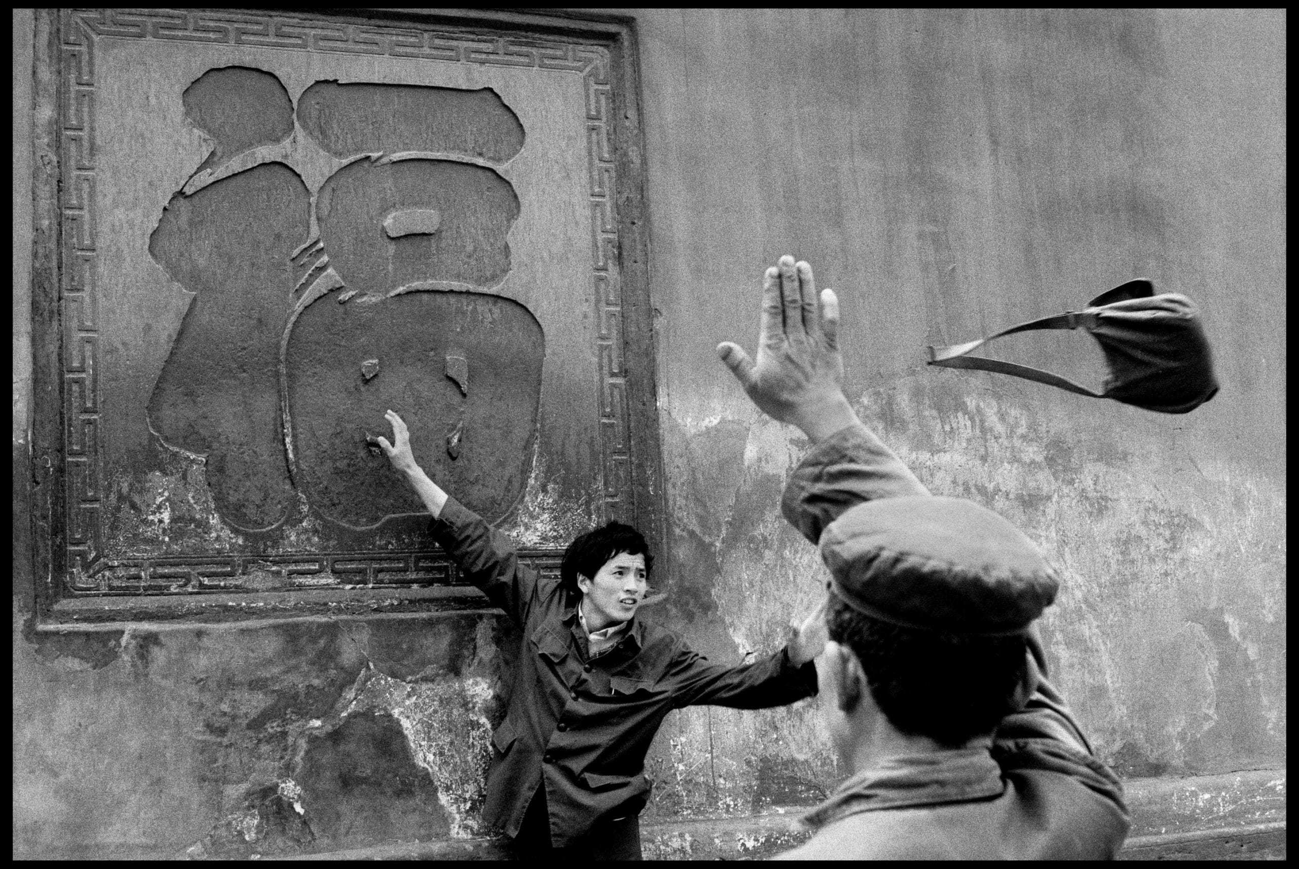 CHINA. Province of Sichuan. Xindu. Monastery of BAO GUANG (Divine Light). Buddhist temple. On the wall: inscription symbolizing happiness, which the visitors, with their eyes shut, try to touch in the center in order to gain happiness. Friday 27th April 1984.
