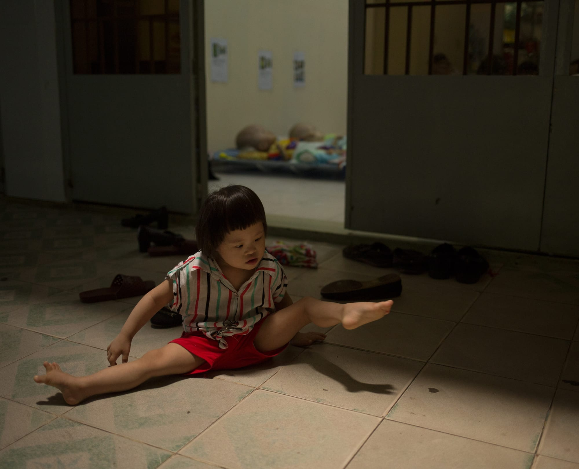 The abandoned children at the orphanage is named after the monks. 2-year old Chân Ngoc Xuân has downs syndrome. She crawls around on her stomach in the hallways for the most.