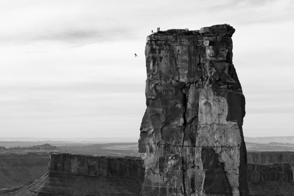 Krystle Wright (Australian, born 1987). Freefall, Michael Tomchek leaps off Castleton Tower (400ft) as fellow BASE jumpers look on, Castle Valley, Utah, 2010, printed 2016. Inkjet print, 13 1/4 x 20 in. (33.9 x 50.8 cm). Collection of Krystle Wright