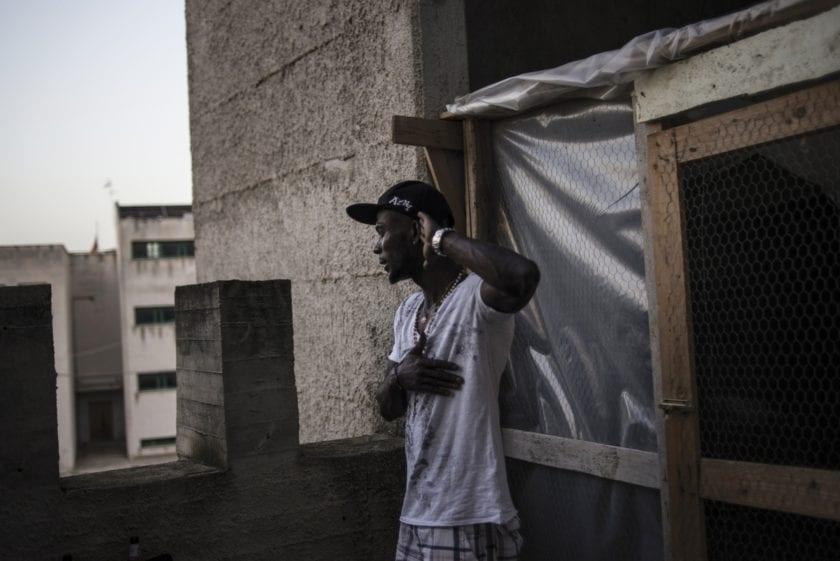 Palermo, South Italy, 20 September 2015. Yannick, from the Ivory Coast, on the rooftop of the church of Falsomiele, a rough area in the suburbs of Palermo. Caritas housed him and other asylum seekers within the parish premises.