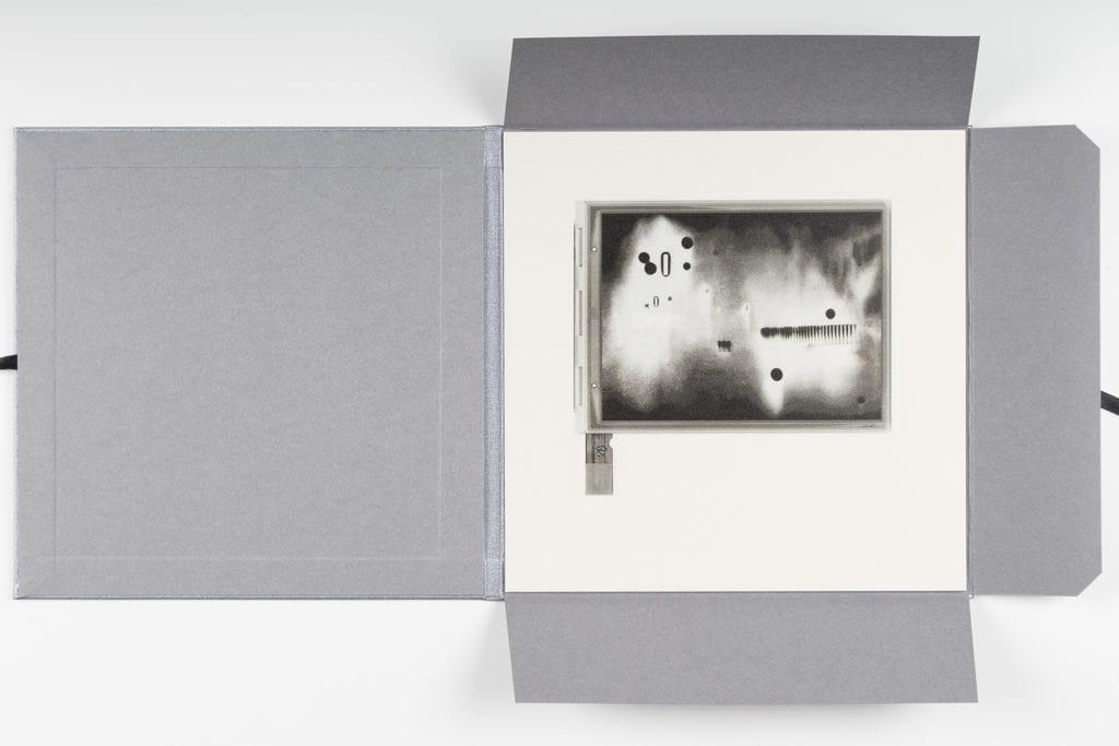 Cairns, Antony, E.I. LDN Collotype Portfolio, 2015. Portfolio of 12 collotype prints on Gampi paper, 20 x 20 cm, edition of 6. © Ollie Hammick
