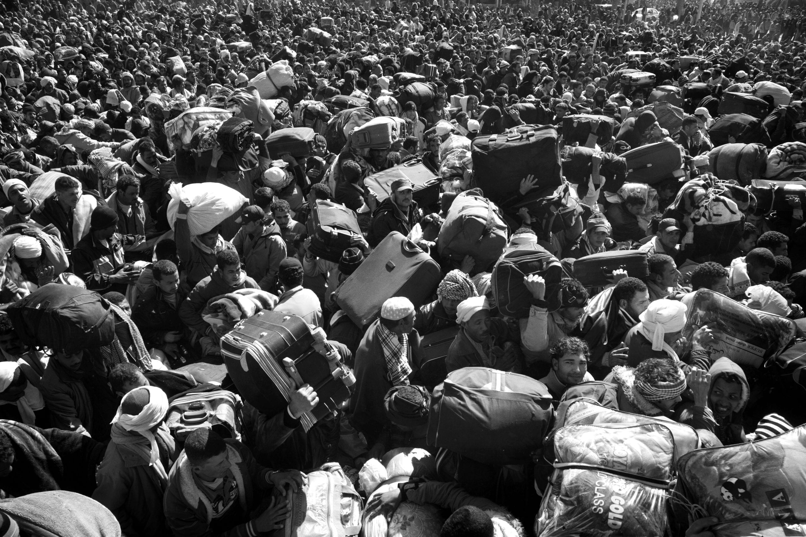 Tunisian, Egyptian and other nationals flee Libya during fighting between rebels and pro Qaddafi forces and arrive at the border crossing in Ras Jdir near Ben Gardenne, Tunisia. 2011