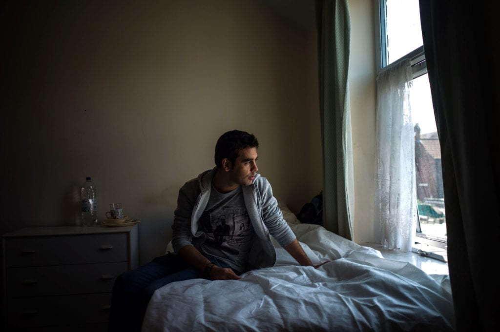 Programme Name: Exodus: Our Journey to Europe - TX: n/a - Episode: n/a (No. 3) - Picture Shows: awaiting the outcome of his asylum application in Wakefield. Ahmad - (C) Gus Palmer / KEO Films - Photographer: Gus Palmer