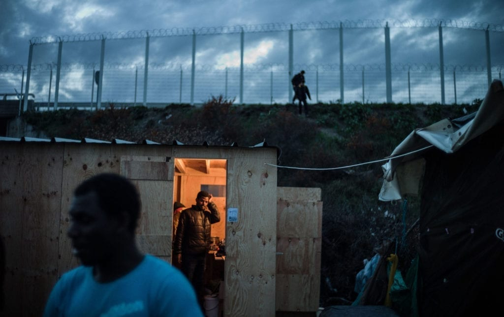 Programme Name: Exodus: Our Journey to Europe - TX: n/a - Episode: n/a (No. 3) - Picture Shows: Cabins in the Calais Jungle. - (C) Gus Palmer / KEO Films - Photographer: Gus Palmer
