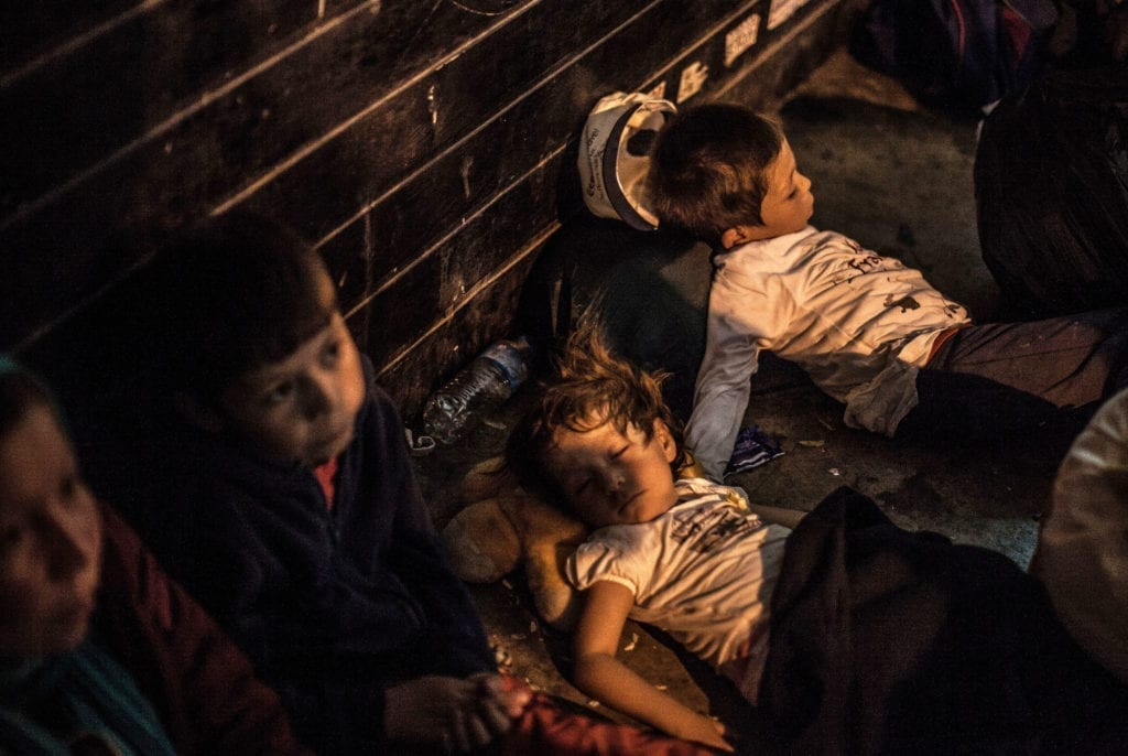 Programme Name: Exodus: Our Journey to Europe - TX: n/a - Episode: n/a (No. 2) - Picture Shows: Afghan Children sleeping in Athens. - (C) Gus Palmer / KEO Films - Photographer: Gus Palmer