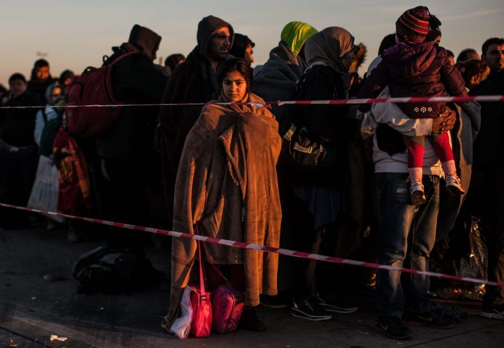 Programme Name: Exodus: Our Journey to Europe - TX: n/a - Episode: n/a (No. 2) - Picture Shows: Refugees waiting to board buses at the Austria/Hungary border. - (C) Gus Palmer / KEO Films - Photographer: Gus Palmer