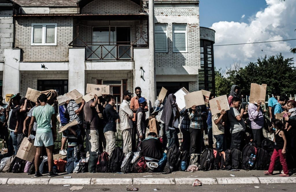 Programme Name: Exodus: Our Journey to Europe - TX: n/a - Episode: n/a (No. 2) - Picture Shows: Refugees arrived from Macedonia waiting for papers to be processed in Presevo Serbia. - (C) Gus Palmer / KEO Films - Photographer: Gus Palmer