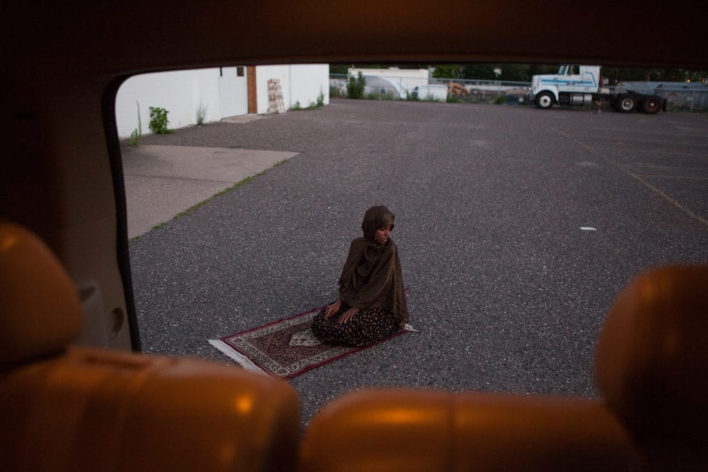 Fartun Mahamoud Abdi prays in the parking lot of a building where she will be opening a new daycare centre catering to Somali children in a suburb of Minneapolis. Ms. Abdi is also currently earning her PhD in radicalisation studies, focusing her research on the Somali community in Minneapolis. She says that instead of taking a top-down approach, law enforcement and community leaders need to listen directly to the Somali youth in order to understand the issues they are facing © Arthur Nazaryan