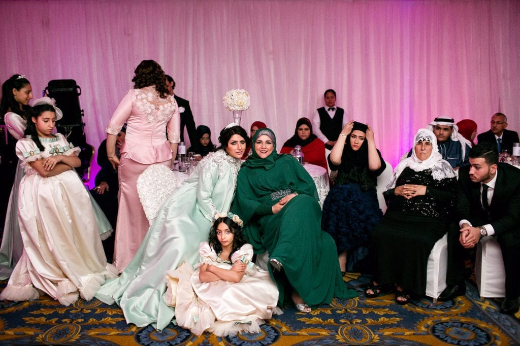 The bride's parents are from Palestine. Making this wedding different than the typical segregated weddings.