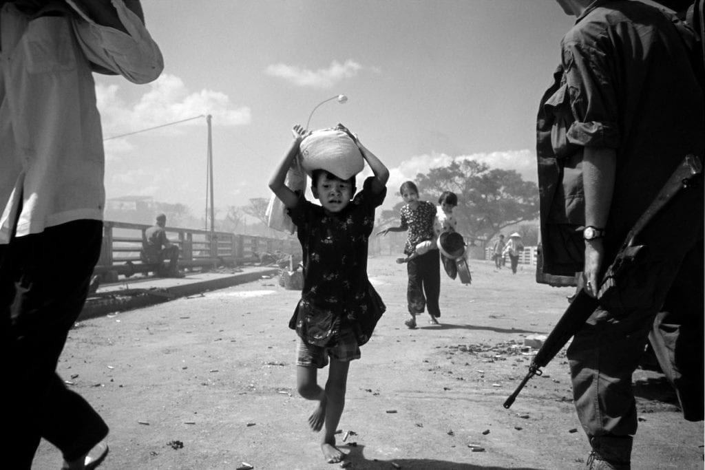 The battle for Saigon. Refugees under fire. Confused urban warfare was such that Americans were shooting their staunchest supporters. Vietnam, 1968. Image © Philip Jones Griffiths/Magnum Photos