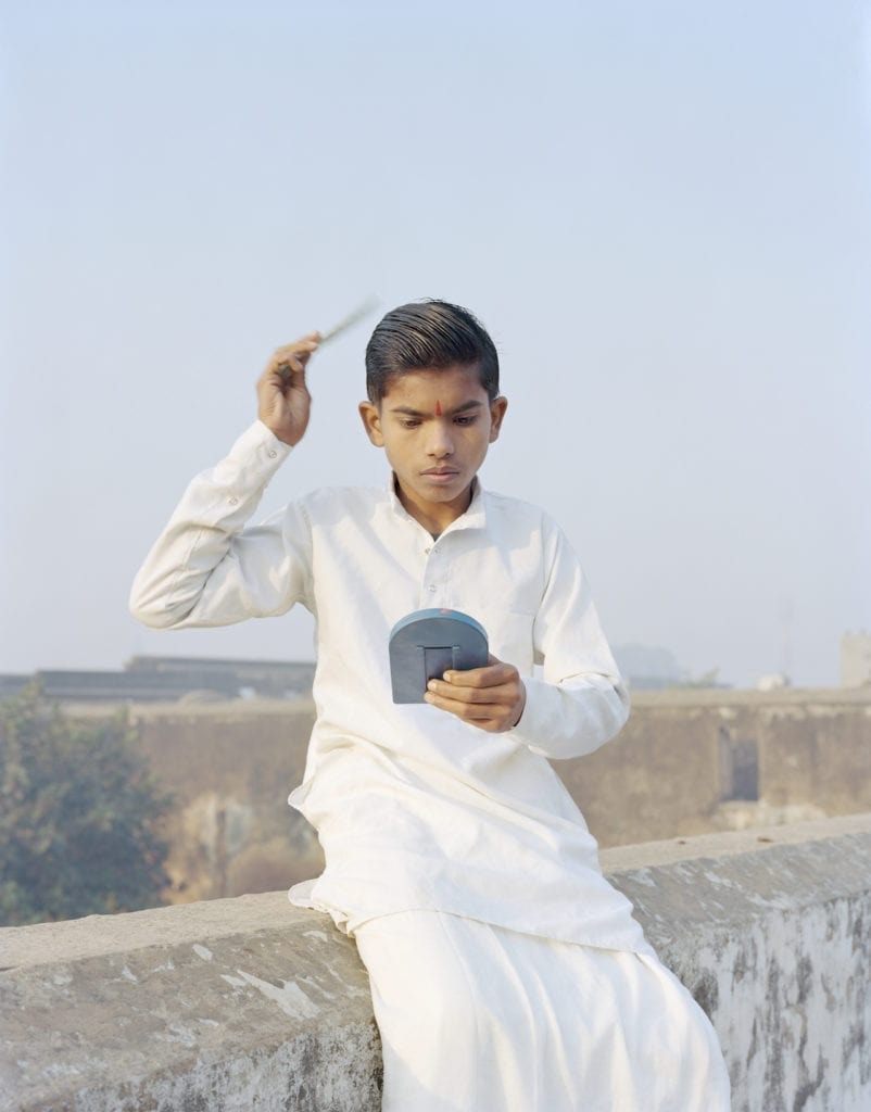 Rama combing his hair, Ayodhya, Uttar Pradesh, 2015. From A Myth of Two Souls © Vasantha Yogananthan
