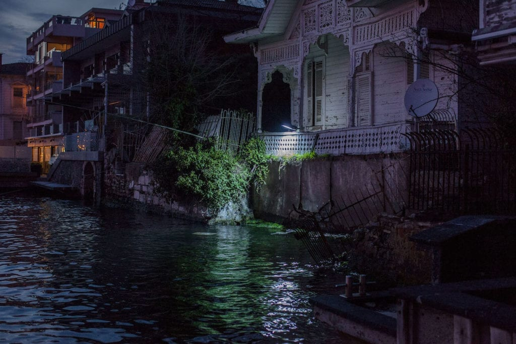 The security lights of a waterfront home on the Anatolian side of the Bosphorus illuminates the water as a Kanal D produced soap opera films in the neighbouring home. From the series The Parallel State © Guy Martin