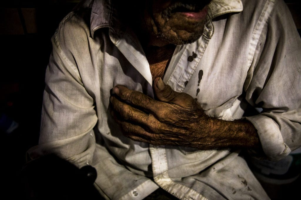 Digno Cruz (the photographer's father-in-law) crying at home in Guerrero, Mexico, while he talking about his missing grandsons. The discovery of several mass graves during the search of the 43 normalistas Ayotzinapa, Guerrero, shows the magnitude of the crisis of enforced disappearances in the country. The government has found 60 clandestine graves in the cities of Iguala-Taxco with at least 129 bodies (20 women and 109 men). None of them belonged to the 43 normalistas who went missing in Iguala during the month of September 2014. Official figures show that in recent years there have been 25 000 700 disappearances and Guerrero is one of the Mexican States worst affected. This image is from the series La casa que sangra , or Broken Roots, by Yael Martinez, which won the photographer second prize in the PHmuseum grant last year. Image © Yael Martinez