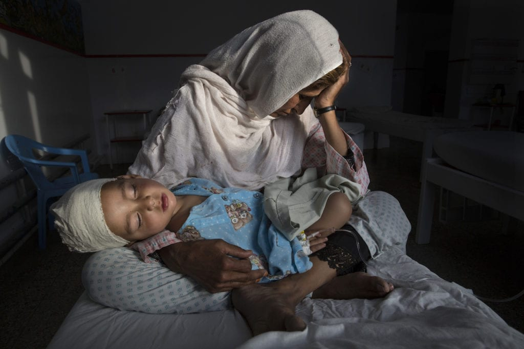 KABUL, AFGHANISTAN -MARCH 29, 2016: A the Emergency hospital Najiba holds her nephew Shabir, age 2, who was injured from a bomb blast which killed his sister in Kabul on March 29, 2016. Najiba had to stay with the children as their mother buried her daughter. In 2016 marked another milestone in its 15-year engagement in Afghanistan. Despite billions of dollars spent by the international community to stabilize the country, Afghanistan has seen little improvement in terms of overall stability and human security. The situation on the ground for Afghans continues to be grave. Security for the Afghan people has also deteriorated in large swaths of the country, further complicating humanitarian response. Afghan civilians are at greater risk today than at any time since Taliban rule. According to UN statistics, in the first half of 2016 at least 1,600 people had died, and more than 3,500 people were injured, a 4 per cent increase in overall civilian causalities compared to the same period last year. The upsurge in violence has had devastating consequences for civilians, with suicide bombings and targeted attacks by the Taliban and other insurgents causing 70 percent of all civilian casualties.