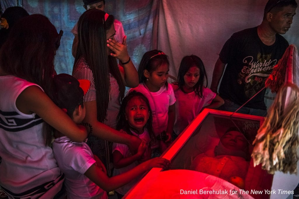 """Six-year old Jimji cries in anguish as she screams """"papa"""" before funeral parlor workers, move the body of her father, Jimboy Bolasa, from the wake at the start of the funeral to Navotas cemetery on October 9, 2016 in Manila, Philippines. Unidentified men abducted Mr. Bolasa and a neighborhood friends one night. Less than an hour later, their beaten bodies, with signs of torture and gunshot wounds were dumped under a nearby bridge. The police claim the men were alleged drug dealers while their family members say they had only surrendered themselves. President Rodrigo Duterte of the Philippines began his anti-drug campaign when he took office on June 30. Since then, over 2,000 people had been slain at the hands of the police alone. Beyond those killed in official drug operations, the Philippine National Police have counted more than 3,500 unsolved homicides since July 1. The victims, suspected users and pushers, are not afforded any semblance of due process, and are killed just about everywhere imaginable. Image © Daniel Berehulak/The New York Times, winner of the General News - Stories category"""