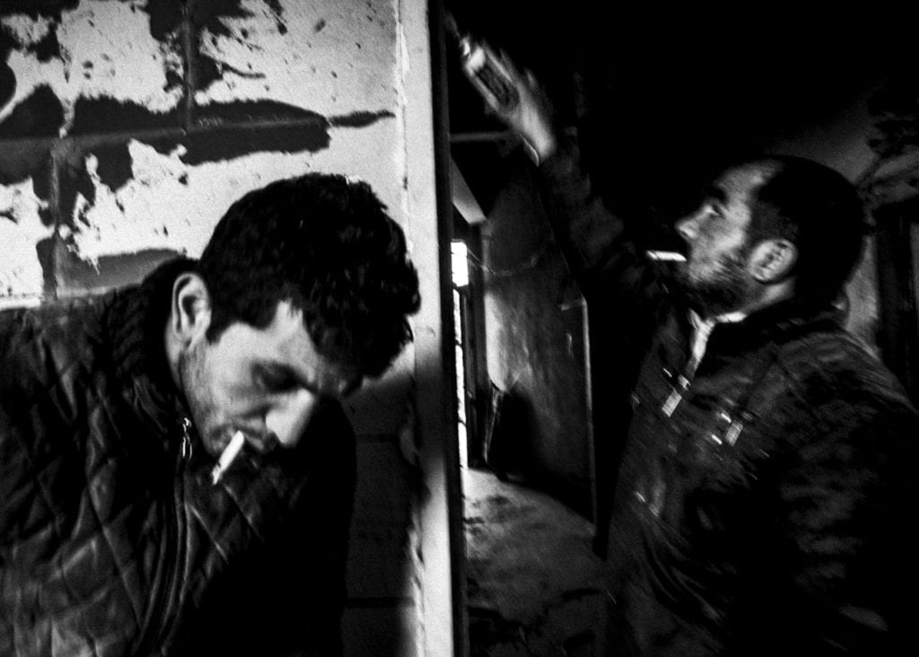 A Syrian refugee repairs a door in an apartment with a Kurdish repairman (left) in the Süleymaniye area, March 2015. From the series November is a beginning © Esa Ylijaasko