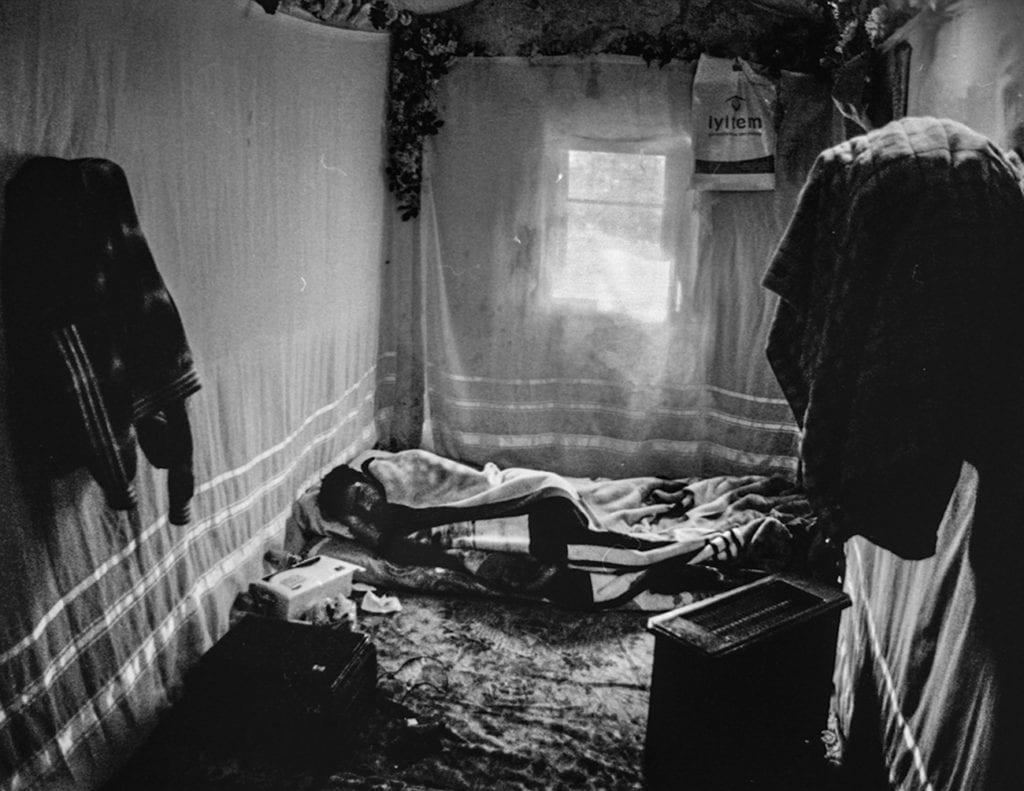 Isam Abu Ali sleeps in bed in his room while sick, Istanbul, Turkey, spring 2015. From the series November is a beginning © Esa Ylijaasko