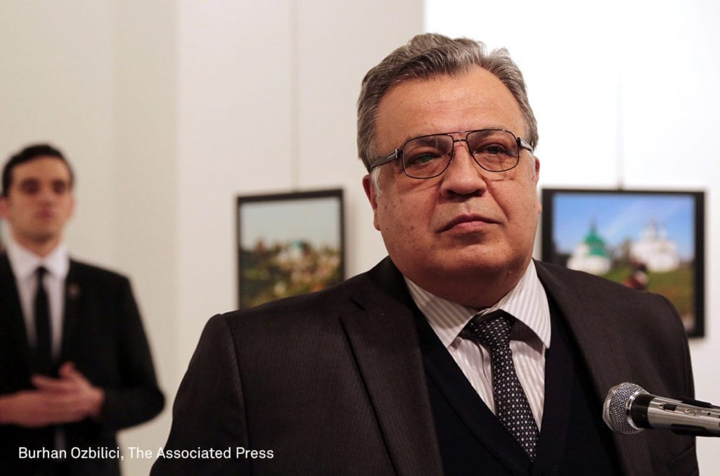 Andrei Karlov, the Russian ambassador to Turkey, speaks at an art gallery before being shot by Mevlut Mert Altintas, left, in Ankara, Turkey, Monday, Dec. 19, 2016. Image © AP Photo/Burhan Ozbilici. First prize, Spot News - Stories