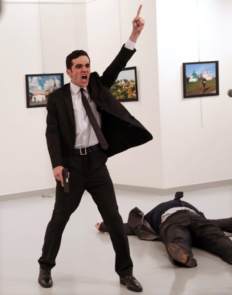 Mevlut Mert Altintas shouts after shooting Andrei Karlov, right, the Russian ambassador to Turkey, at an art gallery in Ankara, Turkey, Monday, Dec. 19, 2016. Image ©