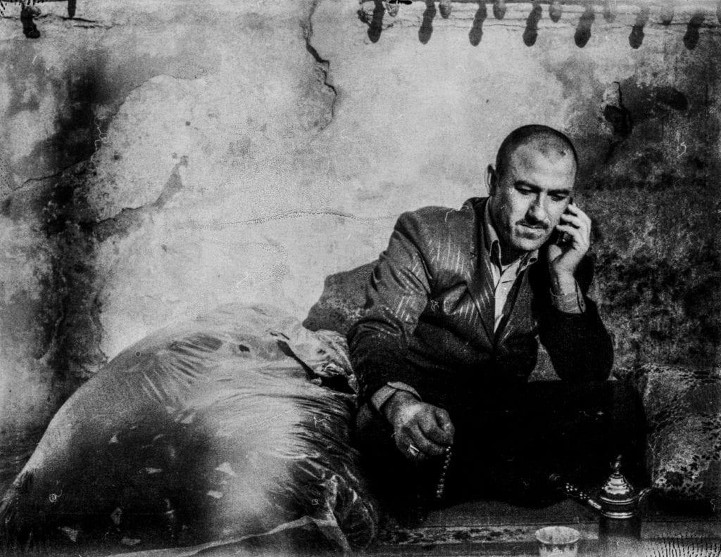 Syrian man speaks on the phone in Süleymaniye, Turkey, March 2014. From the series November is a beginning © Esa Ylijaasko