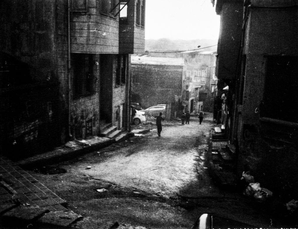A boy runs on the street in Süleymaniye, Istanbul, Turkey, March 2015. From the series November is a beginning © Esa Ylijaasko