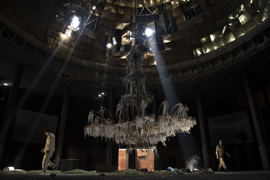 Fighters of the Libyan forces affiliated to the Tripoli government walk around the gigantic chandelier of the conference room in Ouagadougou congress complex Sirte, Libya, July 14, 2016. From the series We are taking no prisoners © Alessio Romenzi, Italy, shortlist, Professional, Current Affairs News category, 2017 Sony World Photography Awards