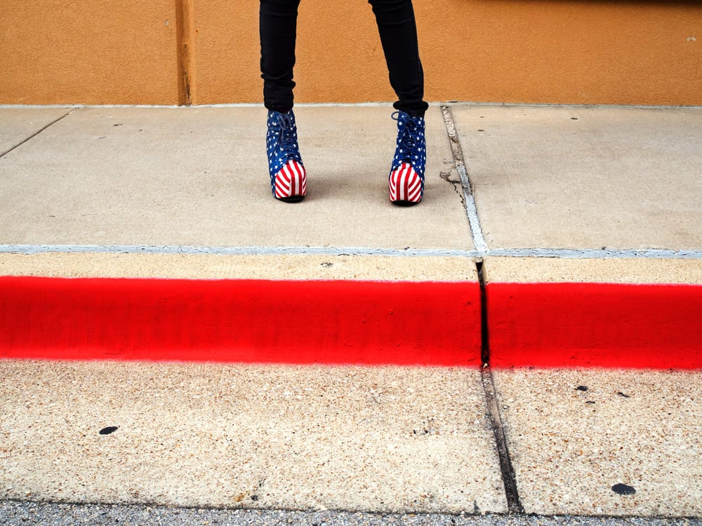 Patriotic footwear worn by Chloe on her way to work in Southlake. Southlake is an affluent city located north-west of Dallas in the U.S state of Texas with a population of arond 26,5700. Southlake was named in 2014 as one of TIME magazines top 10 richest towns in America a and is known for public schools, Southlake Town Square, its wealth, Gateway Church and Carroll High School's 8-time state champion football team. Dallas is a major city in Texas and is the largest urban center of the fourth most populous metropolitan area in the United States. The city ranks ninth in the U.S. and third in Texas after Houston and San Antonio. The city's prominence arose from its historical importance as a center for the oil and cotton industries, and its position along numerous railroad lines. For two weeks in the summer of 2015, photographer Peter Dench visited Dallas to document the metroplex in his epic reportage, DENCH DOES DALLAS. Photographed using an Olympus E-M5 Mark II ©Peter Dench/Getty Images Reportage