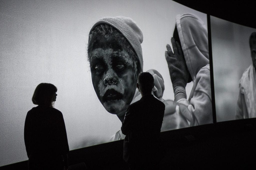 Installation shot of Incoming by Richard Mosse in collaboration with Trevor Tweeten and Ben Frost at The Curve, Barbican. Image © Tristan Fewings/Getty Images for Barbican Art Gallery