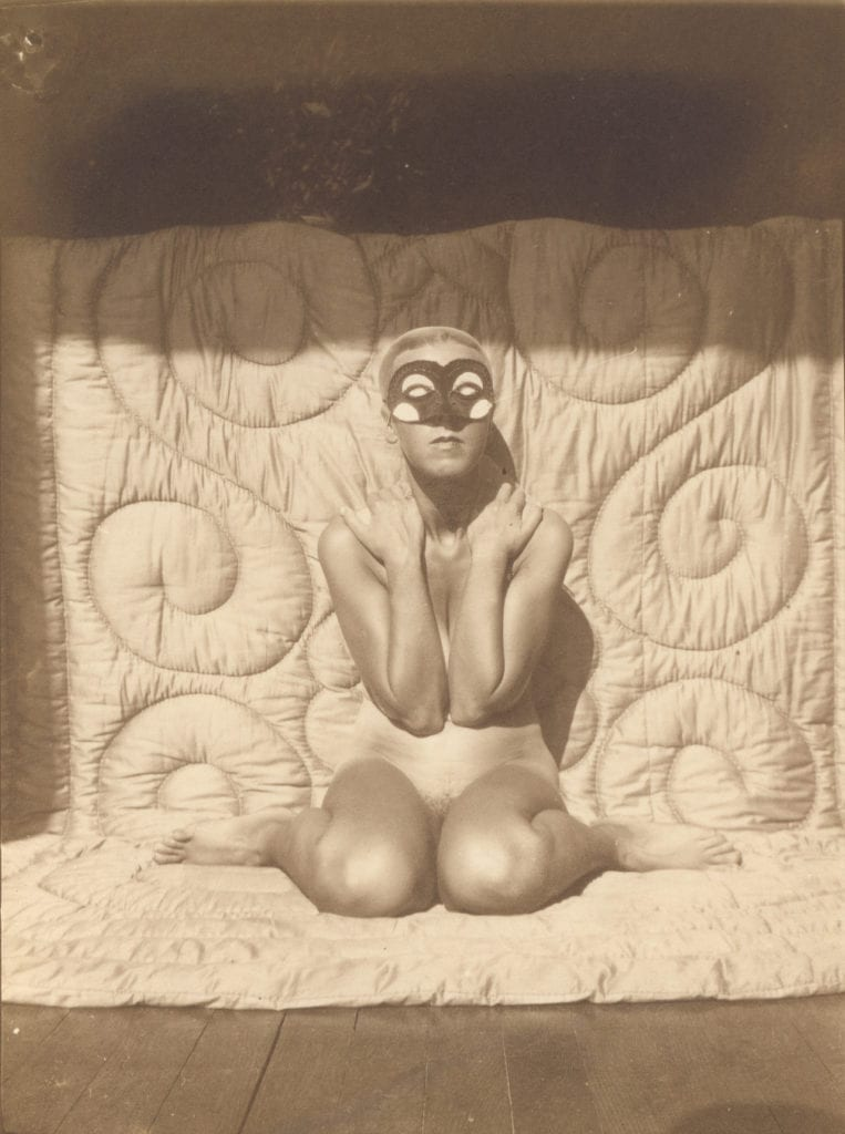 Self-portrait (kneeling, naked, with mask) by Claude Cahun, c.1928 © Jersey Heritage