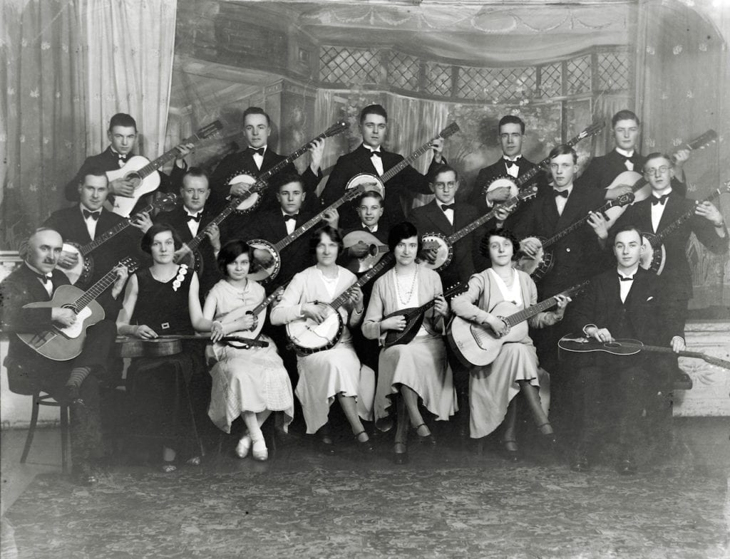Musical group in front of a painted studio backdrop at WW Winter studio, 1920s © WW Winter Ltd