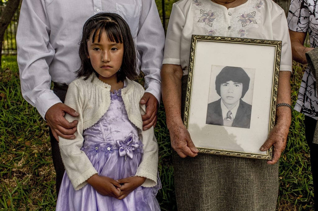 """Nephew of the missing Walter Camino Lopez (in the picture); during the placement of commemorative stones in honor of terrorism victims in """"El ojo que llora""""; a memorial sculpture in Lima. ©Musuk Nolte / Native Agency"""