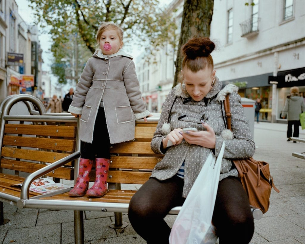 Girl with pink wellies and pacifier, Cardiff. From the series My Favourite Colour Was Yellow © Kirsty MacKay