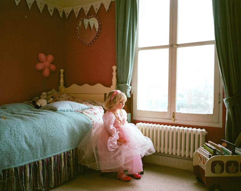 Charlie, dressed up as a princess, at her friend's house. From the series My Favourite Colour Was Yellow © Kirsty MacKay