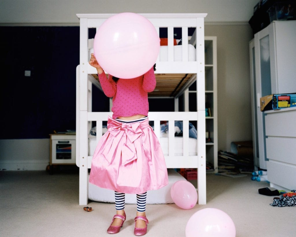 Mabel playing in her bedroom, Bristol, UK. From the series My Favourite Colour Was Yellow © Kirsty MacKay