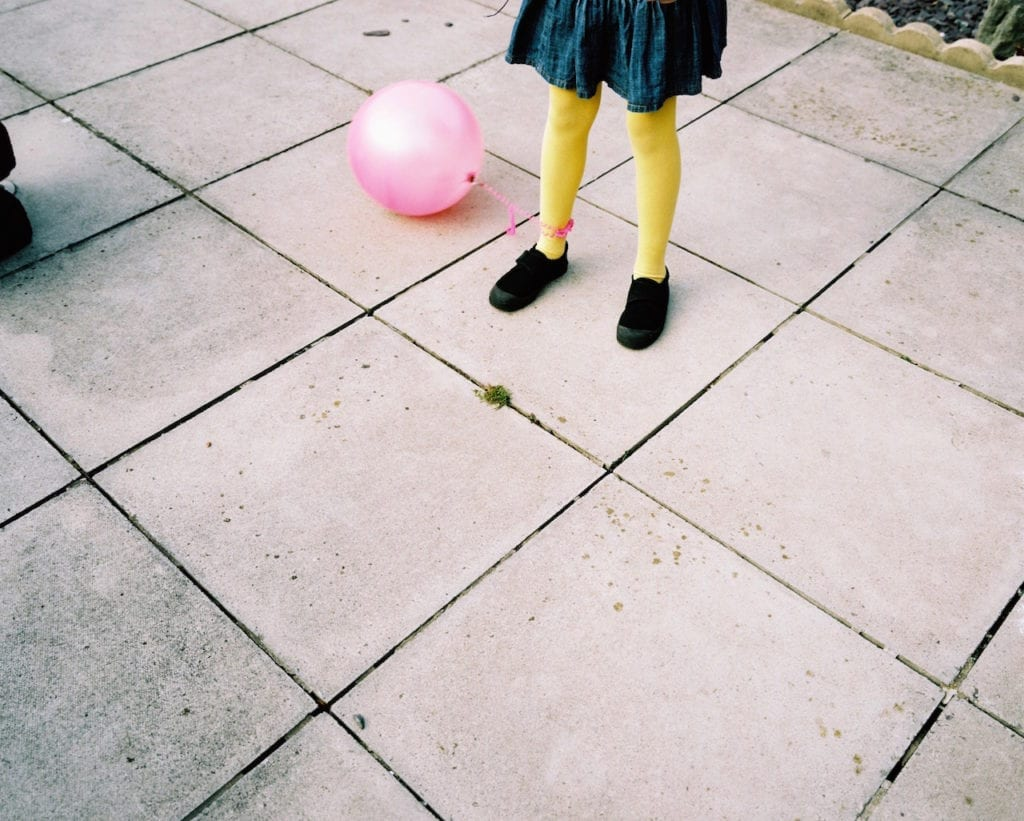 Ball and yellow legs. From the series My Favourite Colour Was Yellow © Kirsty MacKay
