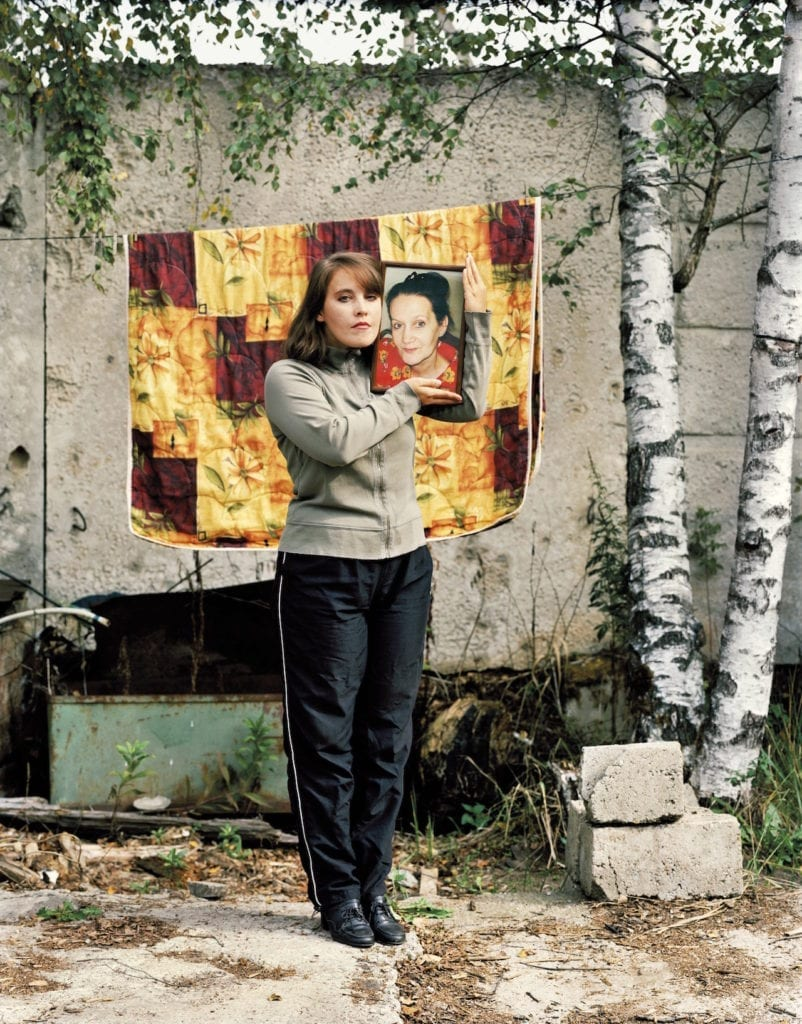Margaret Kiseleva, holding a photograph of her mother, Ludmila, KrioRus facility, Alabushevo, Moscow. September 2010. From The Prospect of Immortality © Murray Ballard