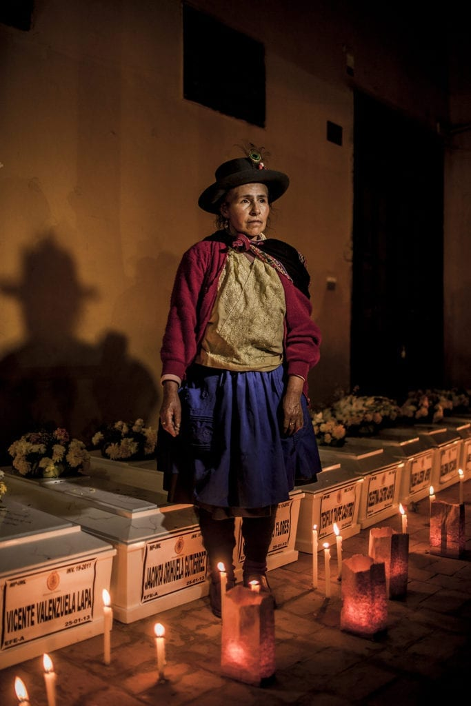 Alejandrina Valenzuela in front of the coffins of her parents; during the memorial service for 74 people from the district of Chungui; in Ayacucho; in the municipal building of Huamanga. © Musuk Nolte / Magnum Foundation