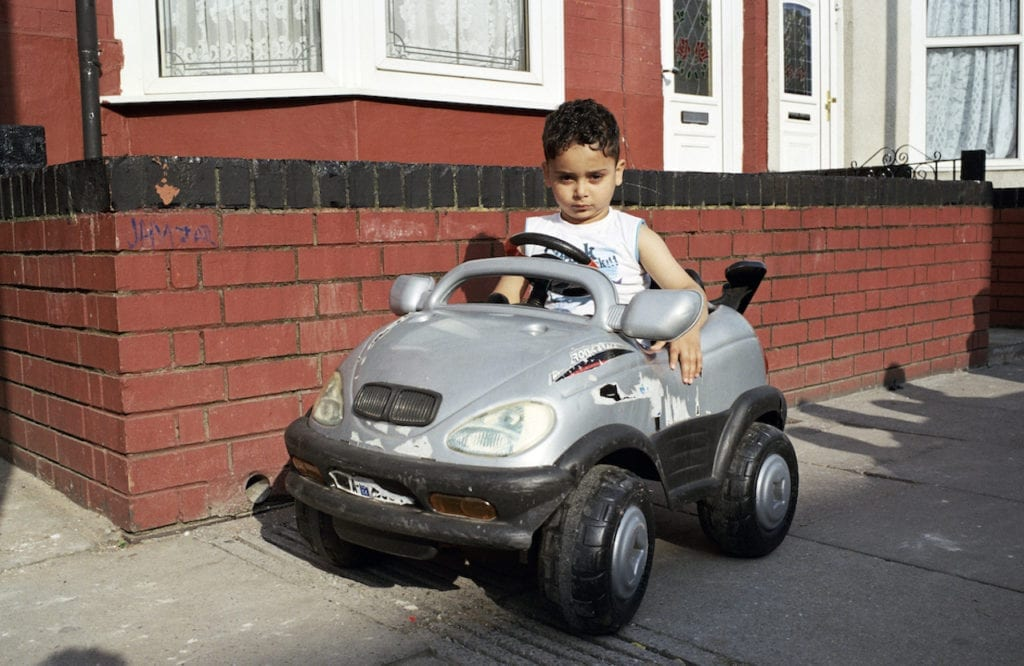 Boy with BMW toy car from the series You Get Me?, 2009 © Mahtab Hussain, courtesy the artist