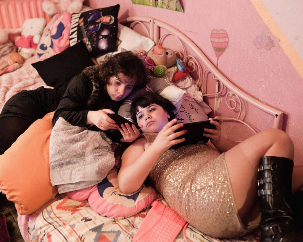 Ilona and Maddelena playing with their new tabs in their bedroom on 21 December 2015, the day Maddelena turned 11. From the series Ilona and Maddelena © Sandra Mehl, which won the Cortona On The Move prize and an exhibition at the festival of the same name in the Photographic Museum of Humanity 2017 Grant.