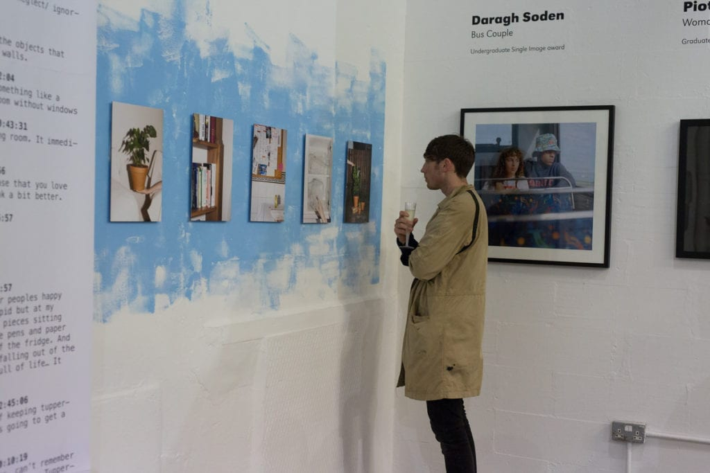 A visitor to the 2016 Breakthrough Awards exhibition admires Jan McCullough's installation. Image © BJP