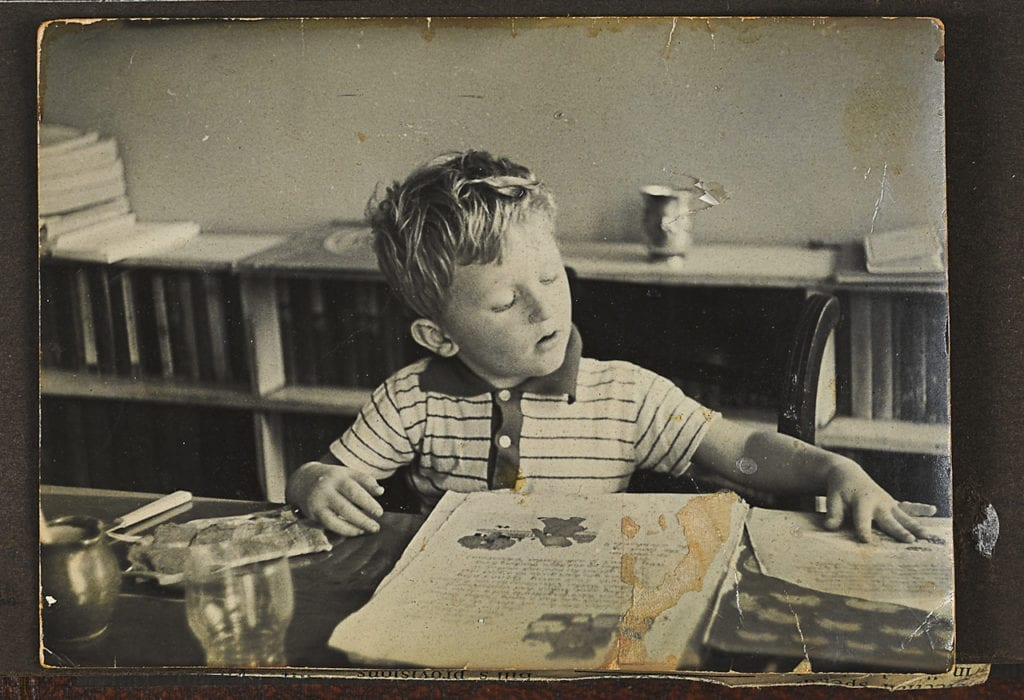 Justin, aged about 5, reading Ba Ba the Elephant at home in Richmond. From the series Big Brother © Louis Quail