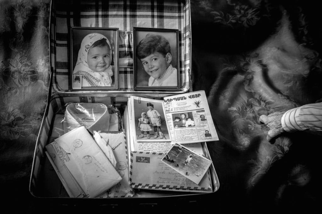 A suitcase filled with items my grandfather put aside in case he would meet us one day. From the series Inventing my father © Diana Markosian, courtesy of Magnum Photos