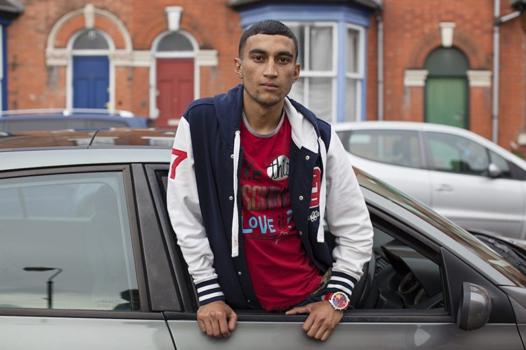 Red T-Shirt, baseball jacket, car, from the series You Get Me?, 2009 © Mahtab Hussain, courtesy the artist