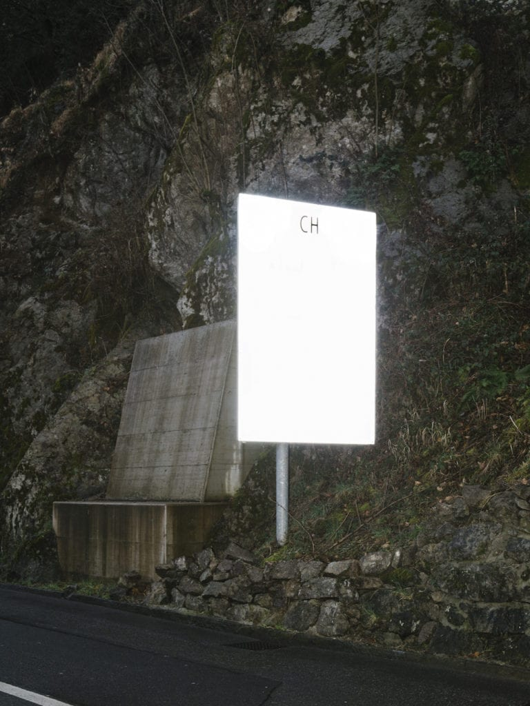 Sign at the entrance of the Swiss territory from a peripheral custom, from the series 'How to secure a country' © Salvatore Vitale, courtesy of the artist