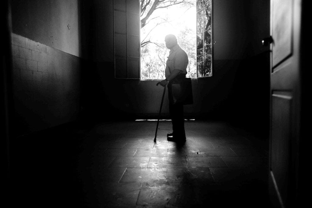 Victor Basterra was kidnapped and brutally tortured at the ESMA. He has been photographed into the office of Miguel Adolfo Donda, one of the most brutal torturers of the barracks, Buenos Aires, Argentina, 2008 © Giancarlo Ceraudo, courtesy of the artist