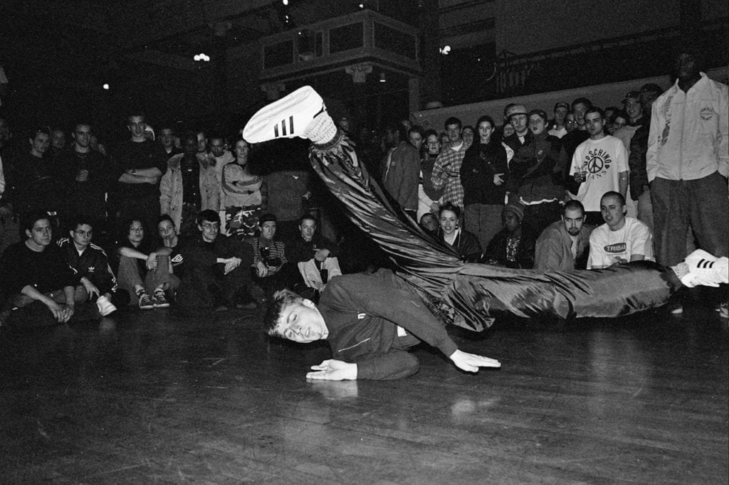 B-Boy, shot at the Fresh Hip Hop event of1997, which featured the UK performances by Jurassic 5 & The Invisibl Skratch Piklz alongside Grandmaster Caz (Cold Crush Brothers), Blade,DJFirst Rate (Scratch Perverts) and many other artists and B-Boys from around the world. Image © Ali Tollervey