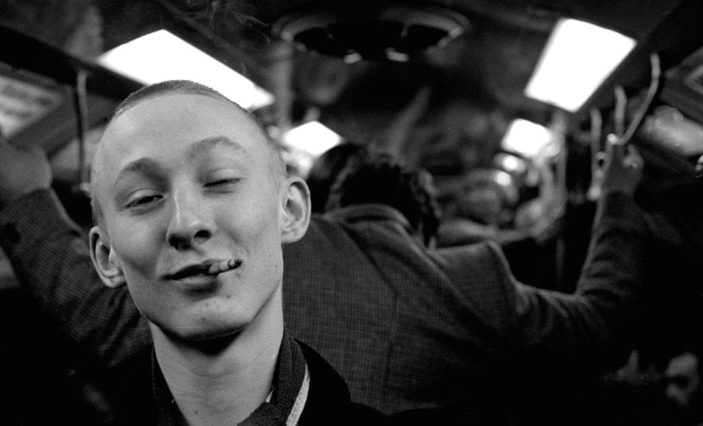 Skinny Jim, from the series Skins & Punks © Gavin Watson. Although skinhead style had become associated with the right-wing extremism of political groups like the National Front in the 1970s, Watson's photographs document a time and place where the subculture was racially mixed and inclusive.