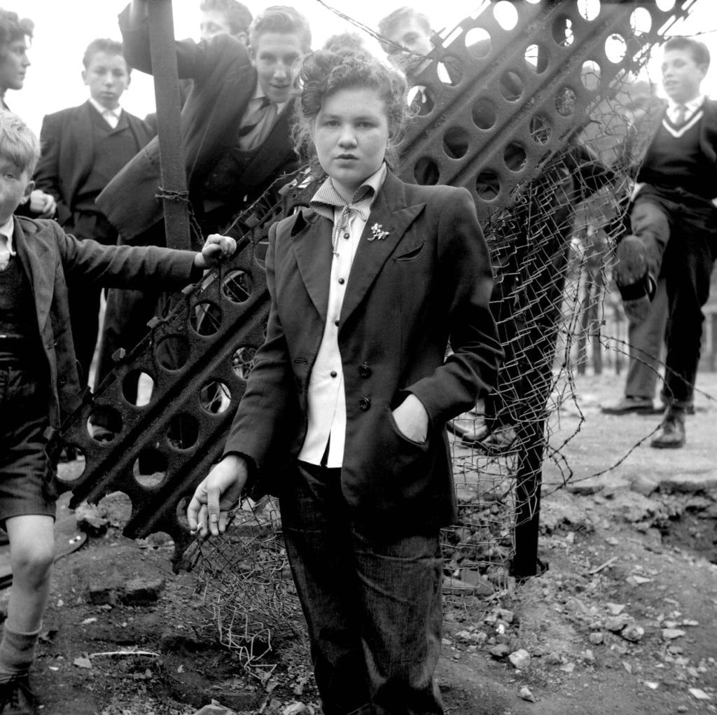 In Your Dreams, January 1955, from the series The Last of the Teddy Girls and showing the then-14-year-old Jean Rayner in London © Ken Russell. 14 year old Jean Rayner in the exploratory stage of Teddyism. Update: Ted Bunton is the boy behind her head, left of centre, identified by him in January 2017 (and Topfoto presented with a print). Jean Rayner died some time previously.