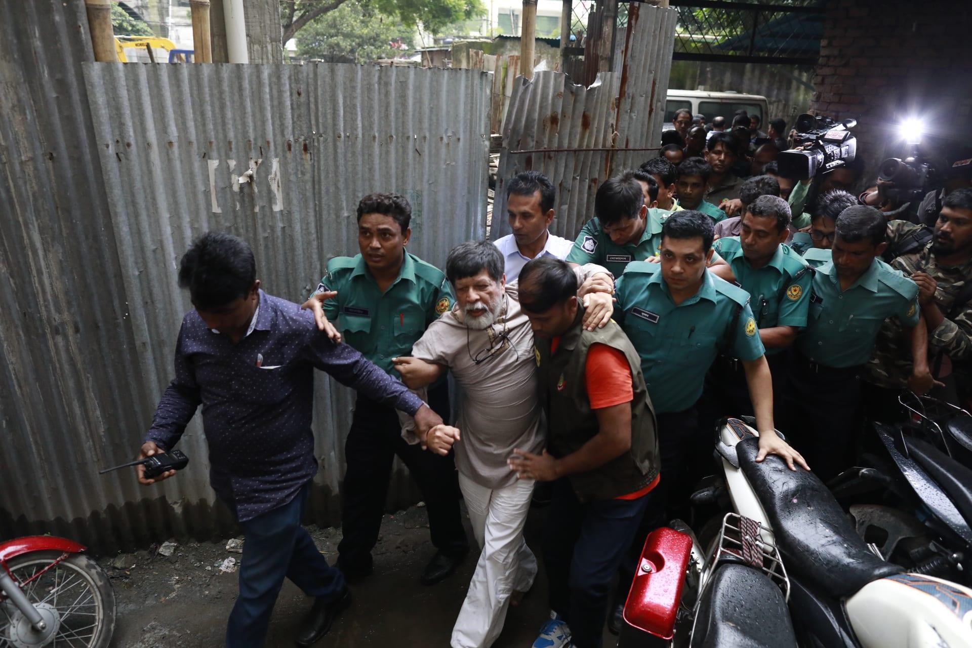 Shahidul Alam being taken to the Chief metropolitan magistrate court, Dhaka